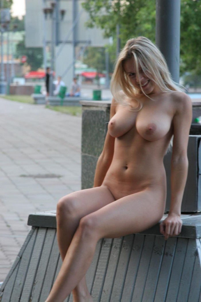 Busty blonde posing naked at public.jpg