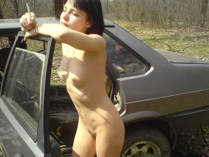 Naked russian girl smokes outdoors.jpg