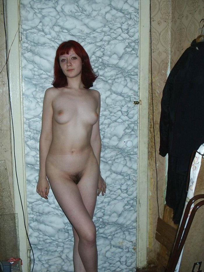 Redhead with hairy pussy at home.jpg