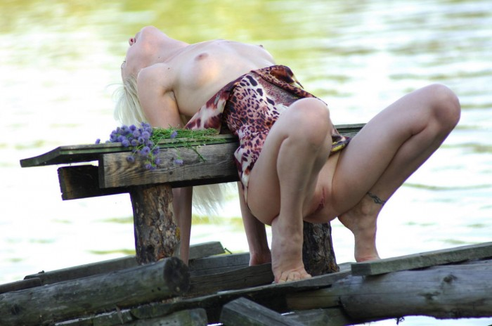 Russian amateur blonde posing outdoors.jpg