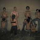 Nude drunken group of young people having fun