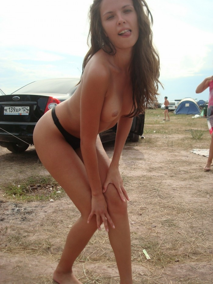 Four girls dancing naked outdoors