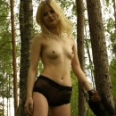 Blonde with small tits at forest