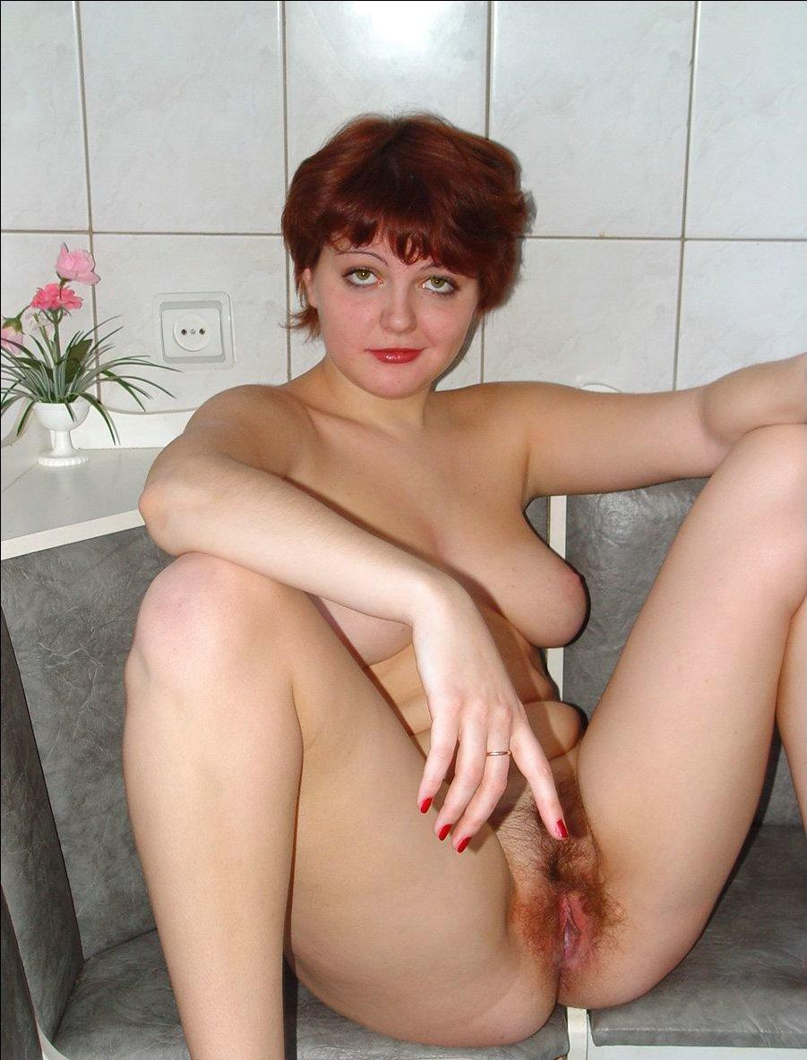 Hot mature redhead strips naked at home