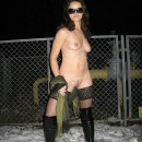 Nice milf posing outdoors at winter night
