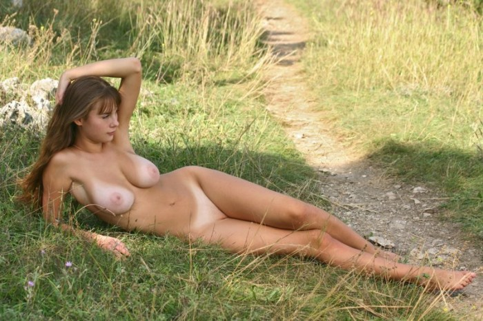 Sexy blonde with sweet tits naked outdoors