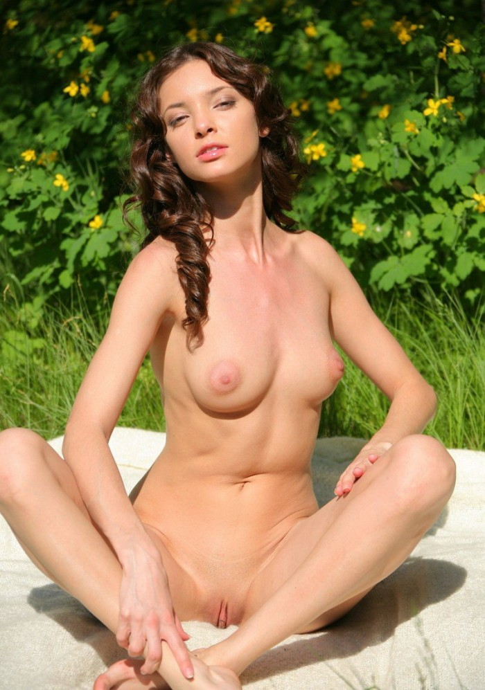 Gorgeous brunette with sweet tits posing outdoors