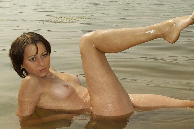 Naked milf on the beach