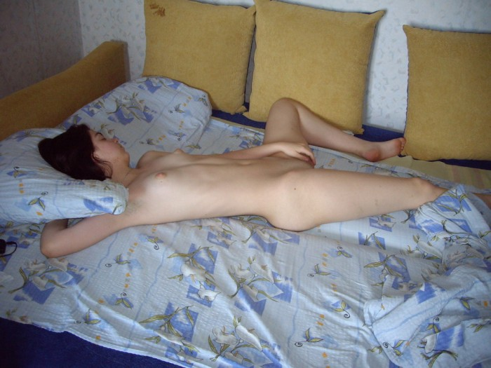 Nice girl posing naked at country house