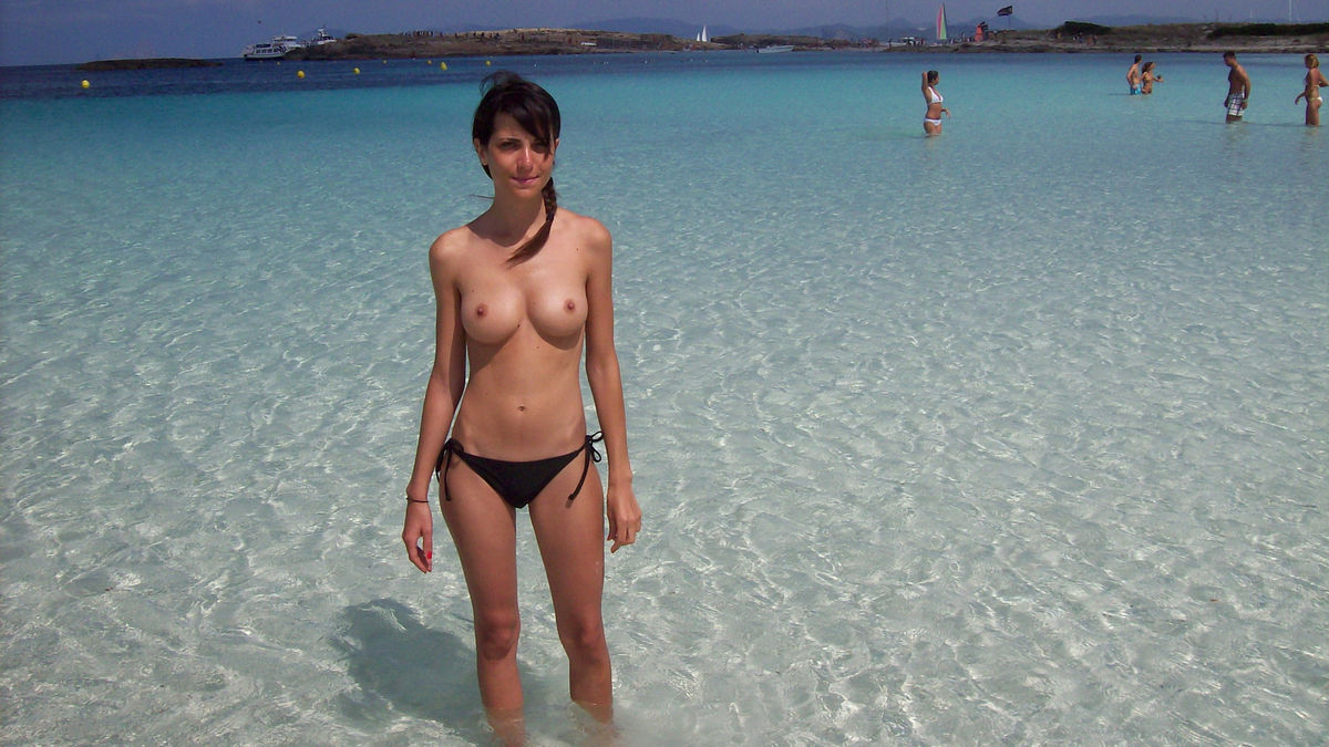 girls showing breasts on beach