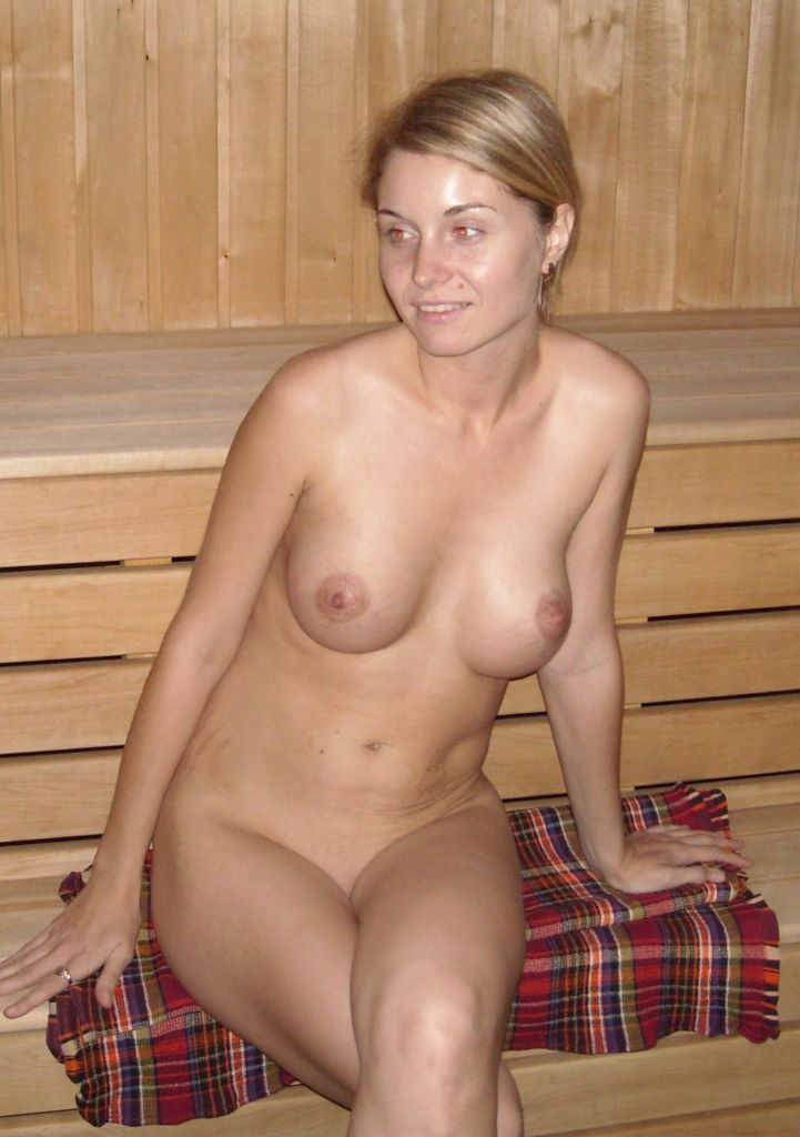 Sexy naked blonde in sauna