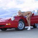 Russian milf blonde naked in the car on the streets
