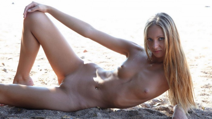 Sporty blonde with perfect body on the beach.jpg
