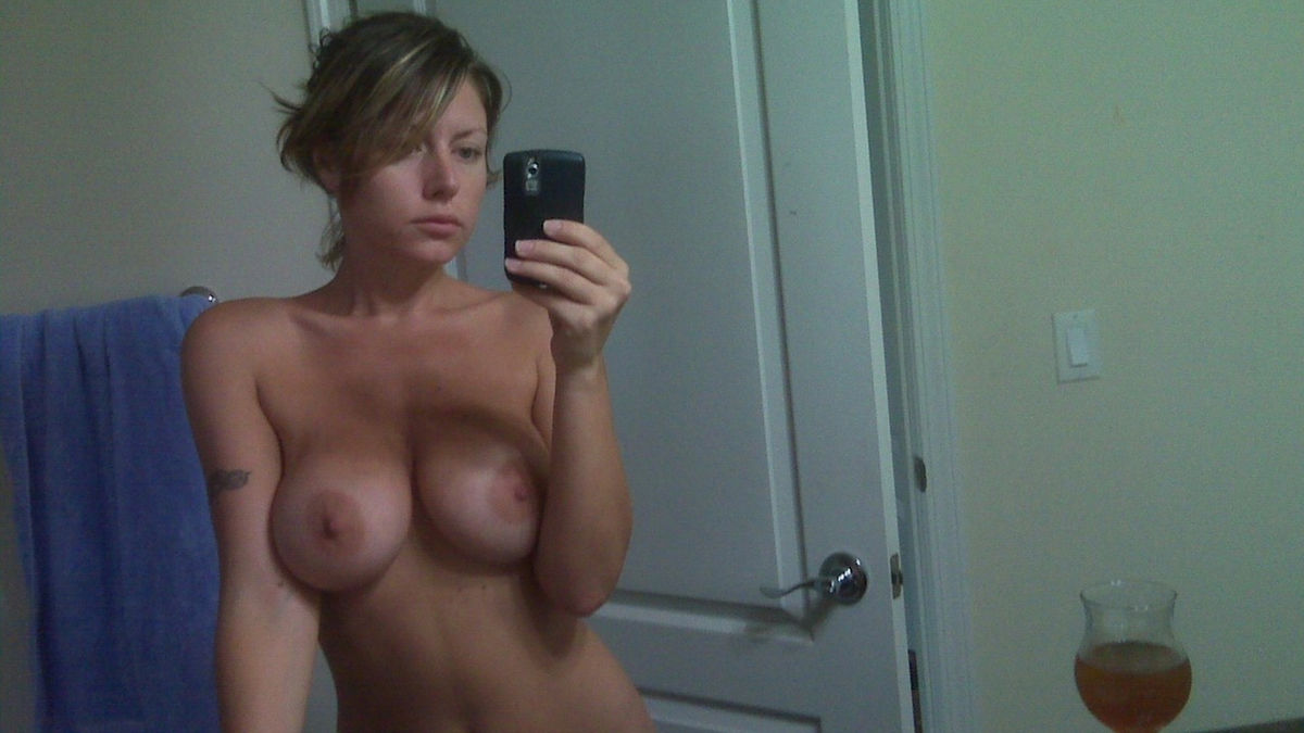 Big breasted women topless selfshot