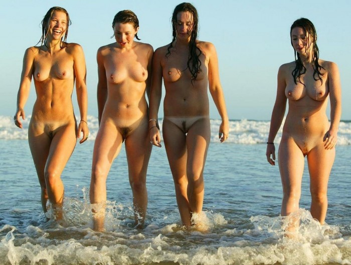 Four busty girls with hairy pussies on the beach