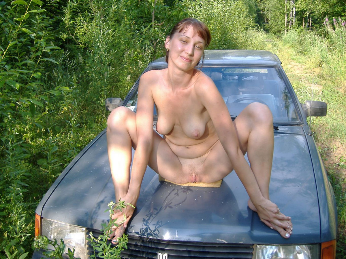 Not Naked girls posing on cars seems