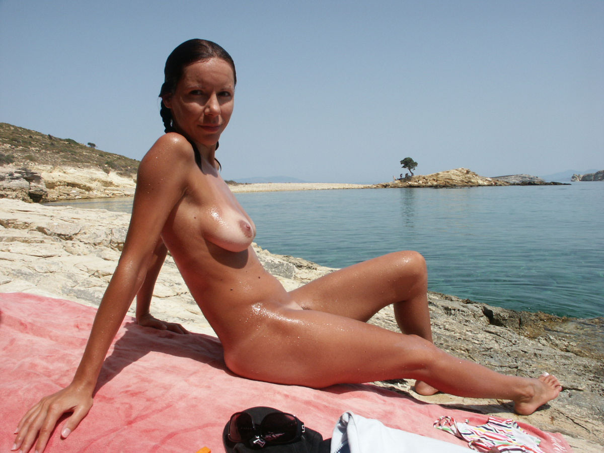 Sexy Milf With Nice Body Tans On Nudist Beach  Russian -8628