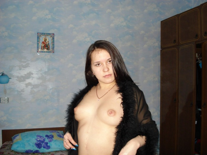 Russian girl in bed after sex