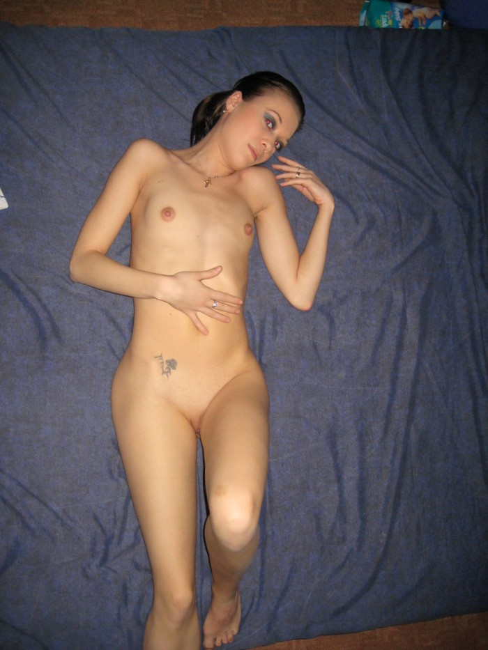 beautiful skinny brunette with small tits posing at home