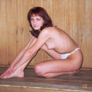 Redhead wife posing naked at sauna and outdoors