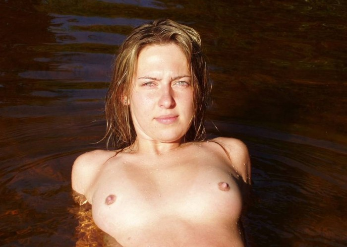 Lovely amateur girl shows tits in lake.jpg