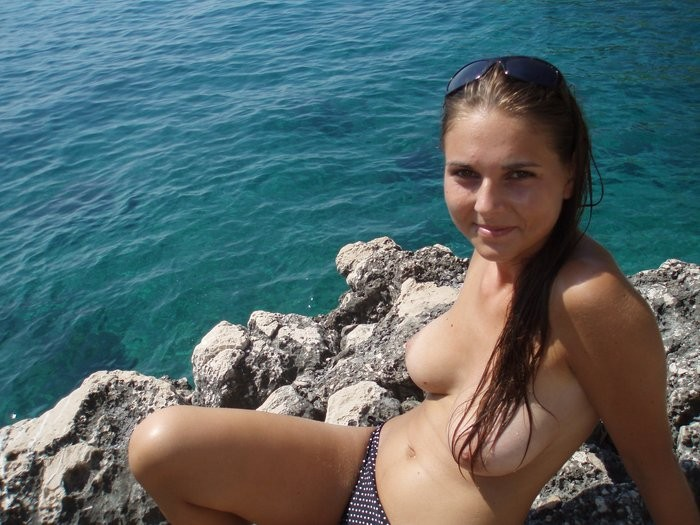 Lovely girl with nice big boobs on the rocks.jpg