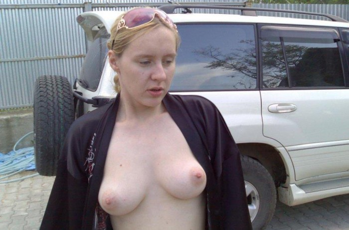 Milf blonde posing topless at home