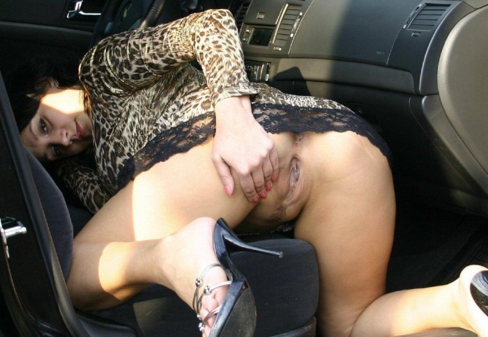 Russian brunette shows ass and pussy at the car.jpg