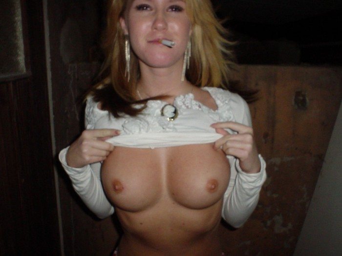 Smoking blonde shows her perfect big boobs.jpg