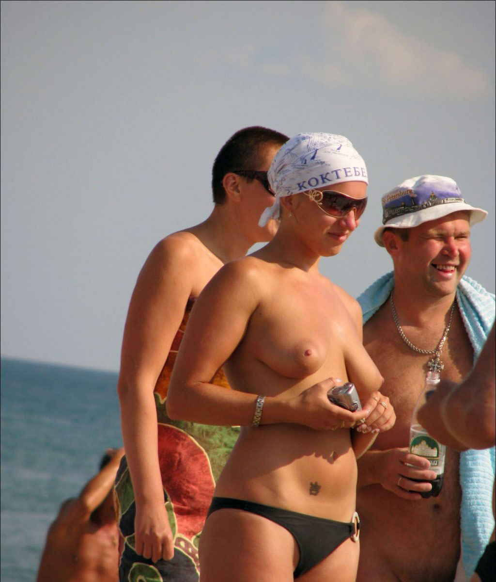 Topless girls in the beach consider