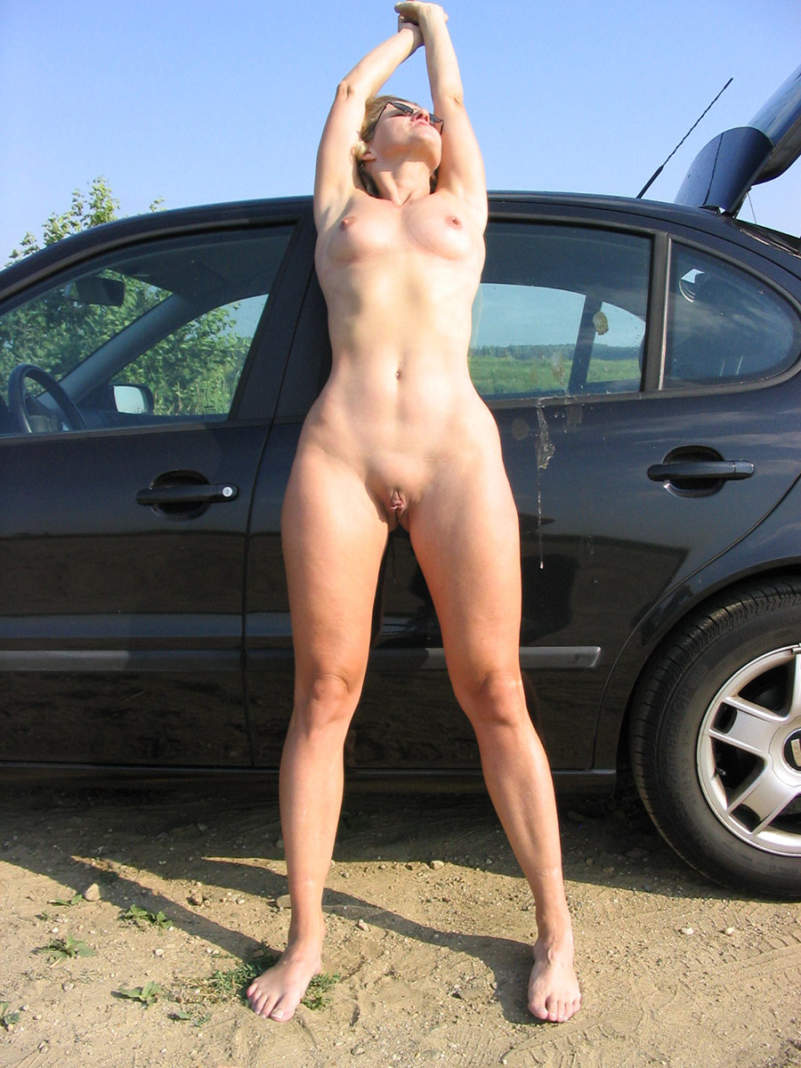 Naked girls posing on cars