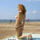 Sexy redhead girl with nice body sunbathes naked at public beach