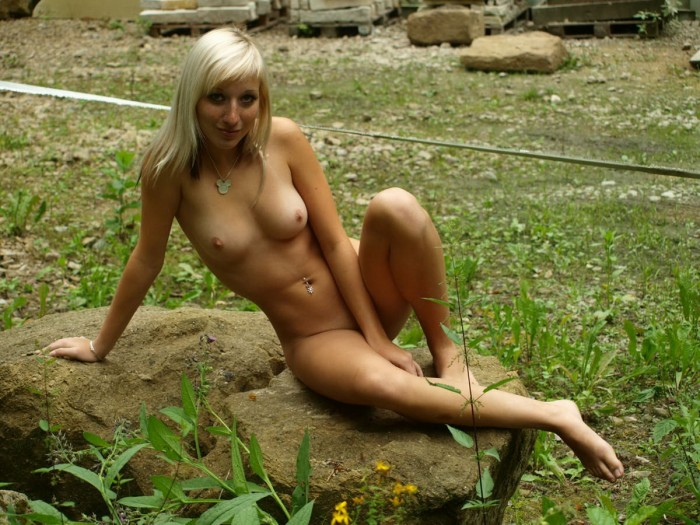 Skinny blonde russian girl with amazing body posing naked outdoors