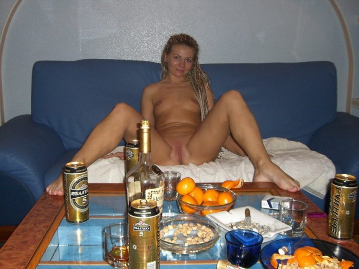 Filthy naughty chick relaxing nude on the bed after a party..jpg