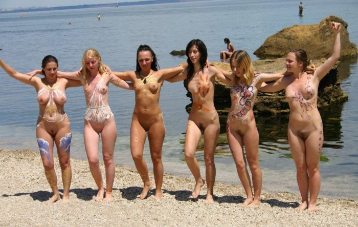 Hot six girls showing their nude painted bodies on the beach..jpg