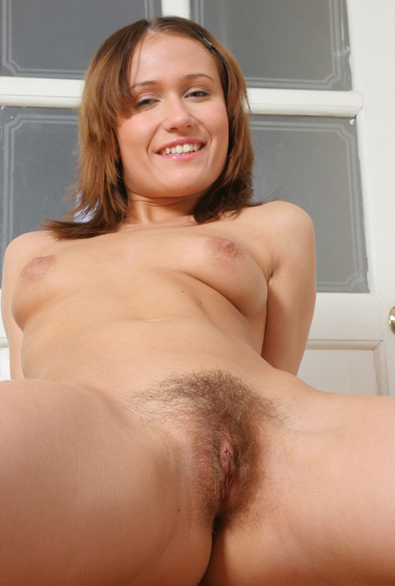 Nasty girl with short haircut shows her hairy vagina. 1 photo