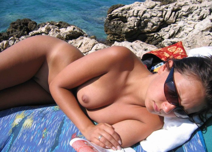 Sexiest amateur girl with ideal boobs posing naked on vacation