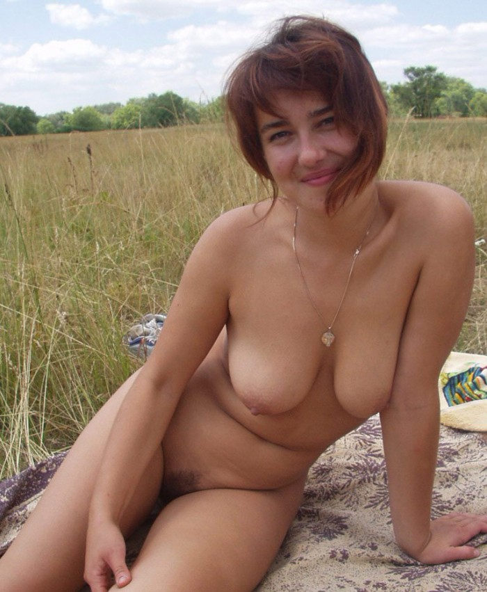 Amateur redhead milf posing naked outdoors