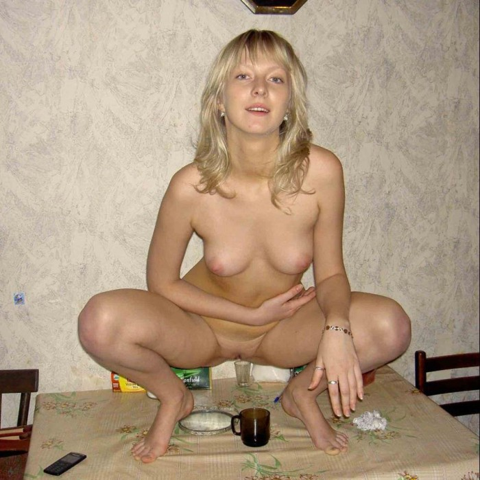 Blond russian beauty getting herself drunk before getting into hardcore sex action.jpg