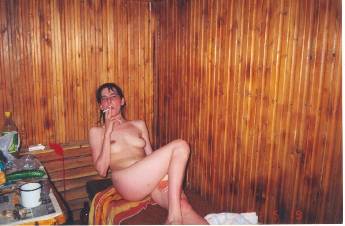 Hot russian girl always smokes nude after the dinner.jpg