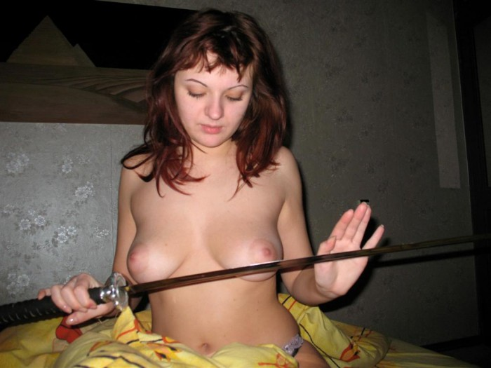 Russian girl shows her nude boobs while playing with a sword.jpg