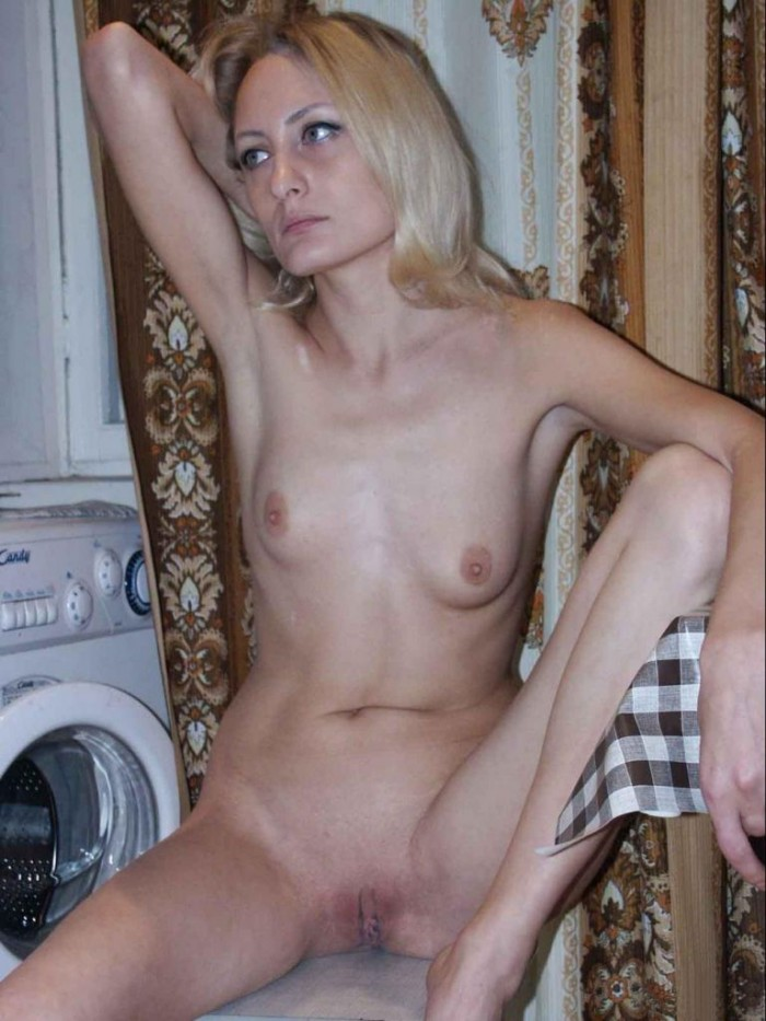 Lovely russian girl with nice body and sweet boobs posing topless