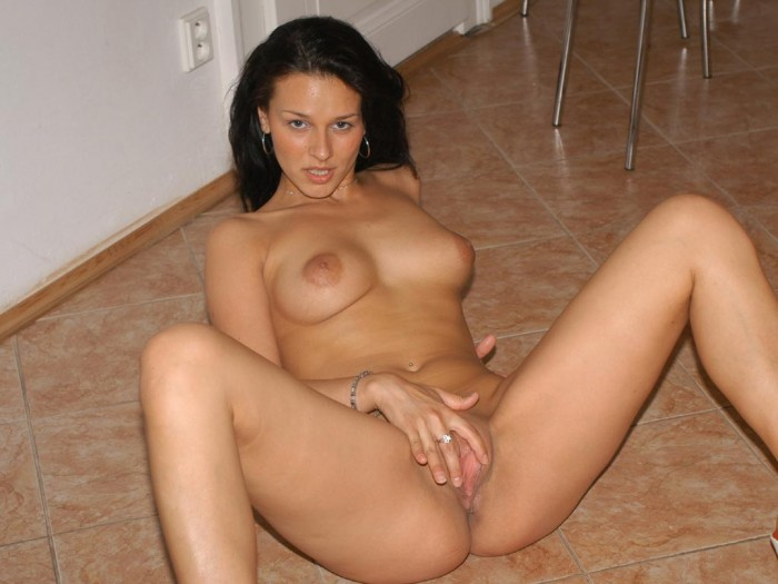 Unbelievable russian brunette shows her clit on the floor.jpg