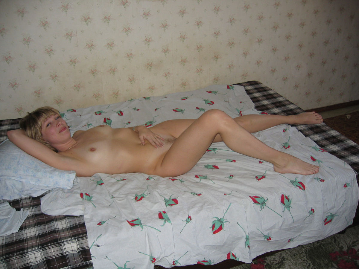 Wonderful Russian Teen With Small Tits Lies Nude On The Bed