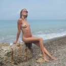 Lovely amateur sporty girl with nice body posing at sea