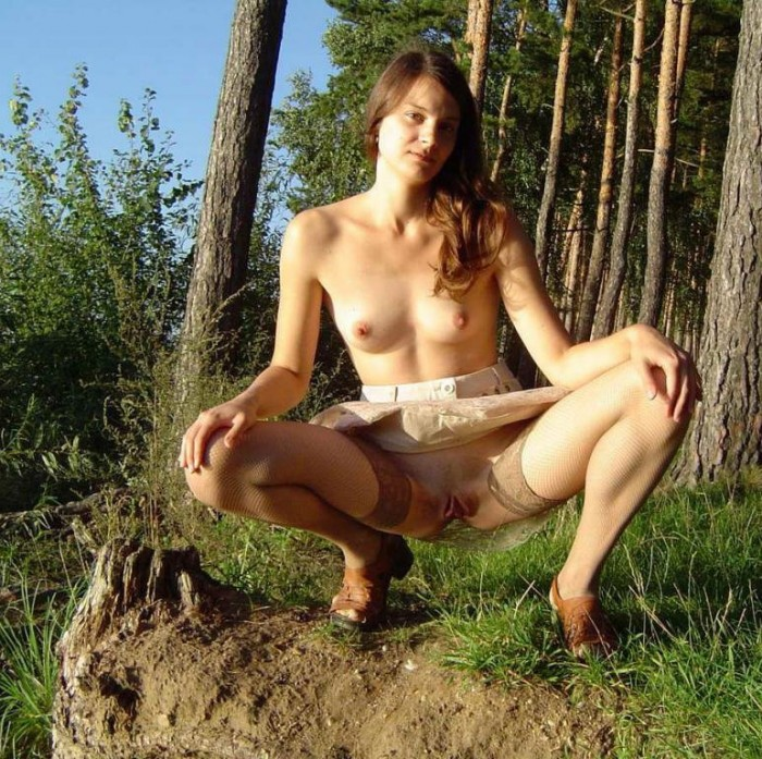 Russian police babe getting a rose and stripping to expose her small natural tits