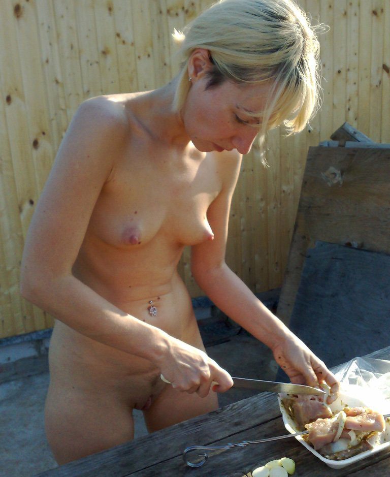a naked girl cooking