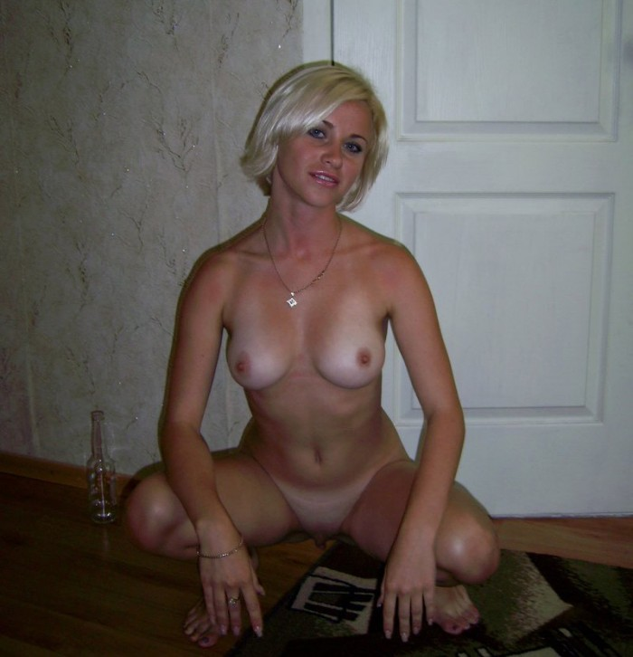 Russian blond chick with short hair and tan lines sitting down exposing her amazing body.jpg