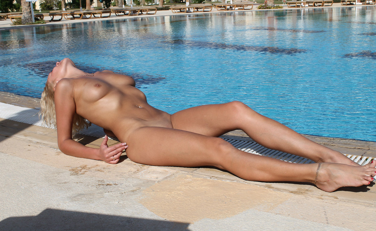 Naked girl swimming pool