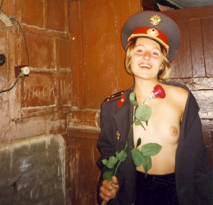 Russian police babe getting a rose and stripping to expose her small natural tits.jpg